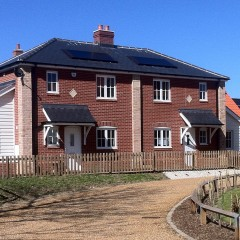 Solar panels on roofs of building in Cherry Tree Close in Wortham