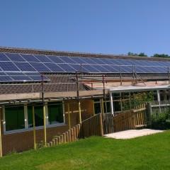 Solar panels being installed on roof of Kelsale Primary School Primary School