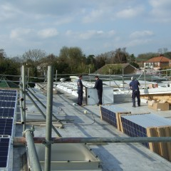Solar Panels being installed on the roof of Sproughton Primary School