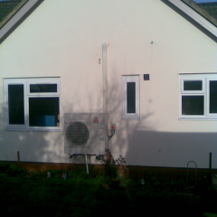 Air conditioning unit on the side of building