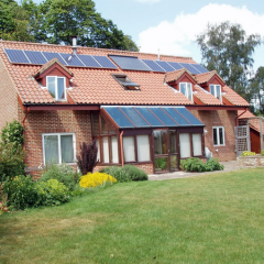 Building with solar panels on roof at Greenways, Levington