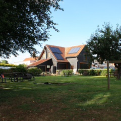 Building with solar panels on the roof at Mill Green Brewery, Edwardstone